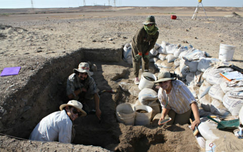 Professor Danielle Macdonald and three other people in an archaeological pit in the Jordanian desert