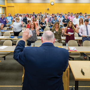 a group of students take an oath at law school reception