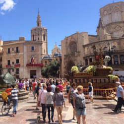 photograph of students abroad on a beautiful sunny day in front of the town square