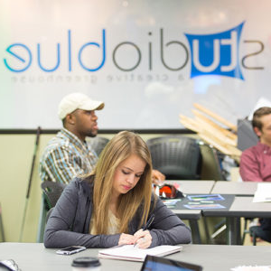 students working on their final project for an entrepreneurship class inside Studio Blue at TU