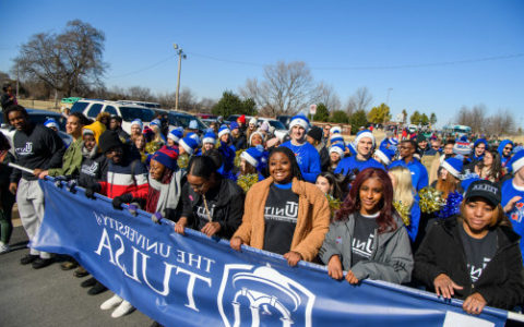 students march during martin luther king jr day parade