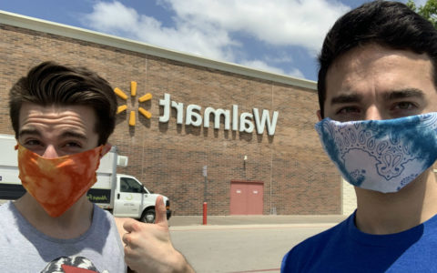 Luke Bertaux and a friend wearing protective face masks outside a Walmart store