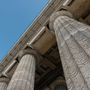 close up picture of pillars against a blue sky