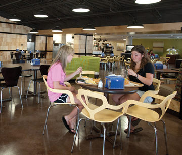 students sitting at tables in the fisher case dining