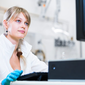 female researcher carrying out research in a high-tech lab