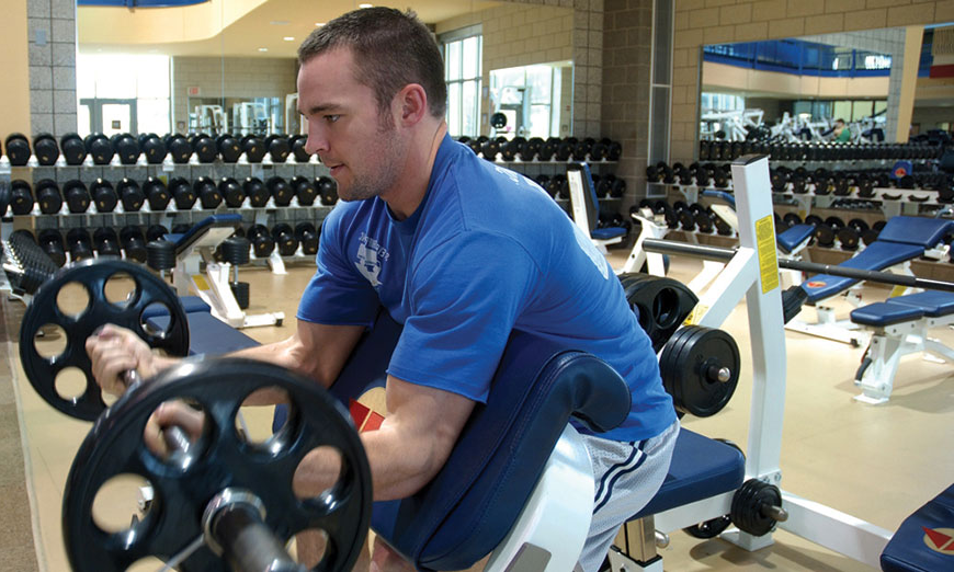 student working out at collins fitness center