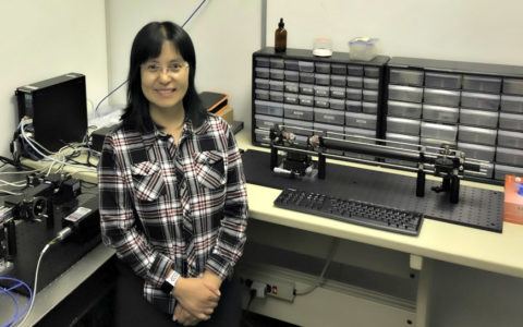 physics professor Peifen Zhu in her lab with research equipment