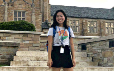 Freshman student Julianne Tran standing in front of 麦克法林库