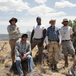 a group photo of students with their professor on a fieldwork excursion