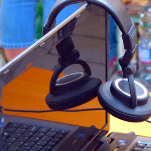 close up photograph of headphones and a laptop